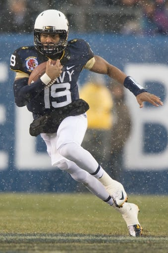 Dec 14, 2013; Philadelphia, PA, USA; Navy Midshipmen quarterback Keenan Reynolds (19) runs with the ball during  the 114th Army-Navy game at Lincoln Financial Field. Navy Midshipmen defeated Army Black Knights 34-7. Mandatory Credit: Tommy Gilligan-USA TODAY Sports