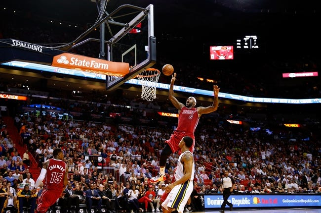 Dec 16, 2013; Miami, FL, USA;  Miami Heat small forward LeBron James (6) dunks the ball as Utah Jazz point guard Trey Burke (3) looks on in the first half at American Airlines Arena. Mandatory Credit: Robert Mayer-USA TODAY Sports