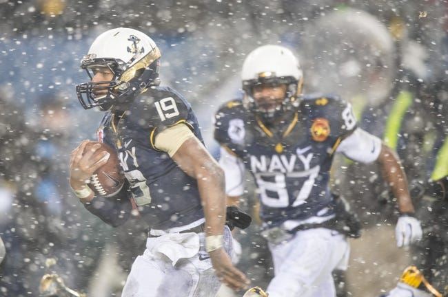 Dec 14, 2013; Philadelphia, PA, USA; Navy Midshipmen quarterback Keenan Reynolds (19) runs with the ball for a touchdown during  the 114th Army-Navy game at Lincoln Financial Field. Navy Midshipmen defeated Army Black Knights 34-7. Mandatory Credit: Tommy Gilligan-USA TODAY Sports