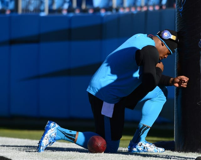 Dec 15, 2013; Charlotte, NC, USA; Carolina Panthers quarterback Cam Newton (1) pauses before the game at Bank of America Stadium. Mandatory Credit: Bob Donnan-USA TODAY Sports