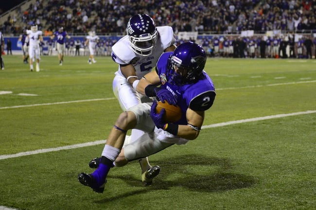 Dec 20, 2013; Salem, VA, USA; UW-Whitewater wide receiver Tyler Huber (2) catches a touchdown pass as Mount Union Purple Raiders defensive back Tre Jones (5) defends in the first quarter at Salem Stadium. Mandatory Credit: Bob Donnan-USA TODAY Sports