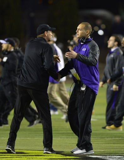 Dec 20, 2013; Salem, VA, USA; UW-Whitewater head coach Lance Leipold (left) shakes hands with Mount Union Purple Raiders head coach Vince Kehres before the game at Salem Stadium. Mandatory Credit: Bob Donnan-USA TODAY Sports