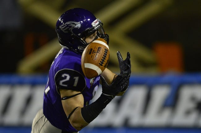 Dec 20, 2013; Salem, VA, USA; UW-Whitewater defensive back Dylan Morang (21) intercepts the ball in the fourth quarter. UW-Whitewater defeated Mount Union Purple Raiders 52-14 at Salem Stadium. Mandatory Credit: Bob Donnan-USA TODAY Sports