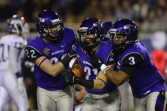 Dec 20, 2013; Salem, VA, USA; UW-Whitewater defensive back Dylan Morang (21) celebrates with defensive backs Andrew Keister (22) and Marcus McLin (3) after intercepting the ball in the fourth quarter. UW-Whitewater defeated Mount Union Purple Raiders 52-14 at Salem Stadium. Mandatory Credit: Bob Donnan-USA TODAY Sports