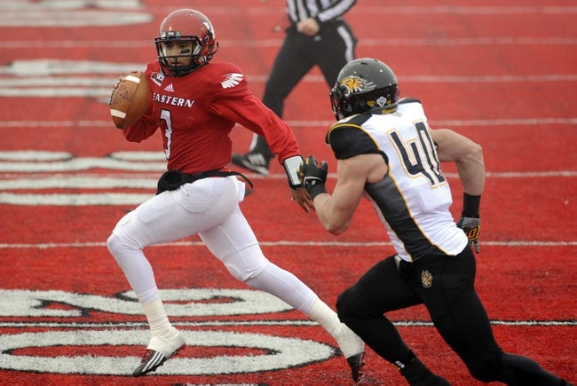 Dec 21, 2013; Cheney, WA, USA; Eastern Washington Eagles quarterback Vernon Adams (3) tries to get by Towson Tigers linebacker Alexander DiSanzo (40) during the second half at Roos Field. The Tiger beat Eagles 35-31. Mandatory Credit: James Snook-USA TODAY Sports