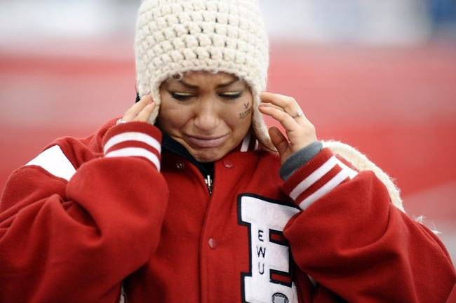 Dec 21, 2013; Cheney, WA, USA; Eastern Washington Eagles student Meghan Howell reacts after a game against the Towson Tigers at Roos Field. The Tiger beat Eagles 35-31. Mandatory Credit: James Snook-USA TODAY Sports