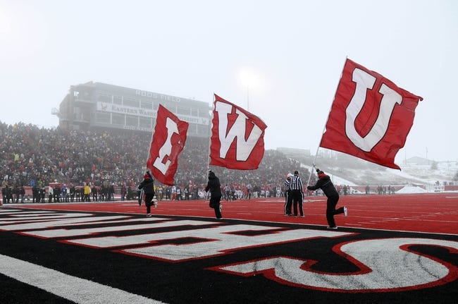 Dec 21, 2013; Cheney, WA, USA; Eastern Washington Eagles  cheerleaders run out the school flags after a score against the Towson Tigers during the second half at Roos Field. The Tiger beat Eagles 35-31. Mandatory Credit: James Snook-USA TODAY Sports