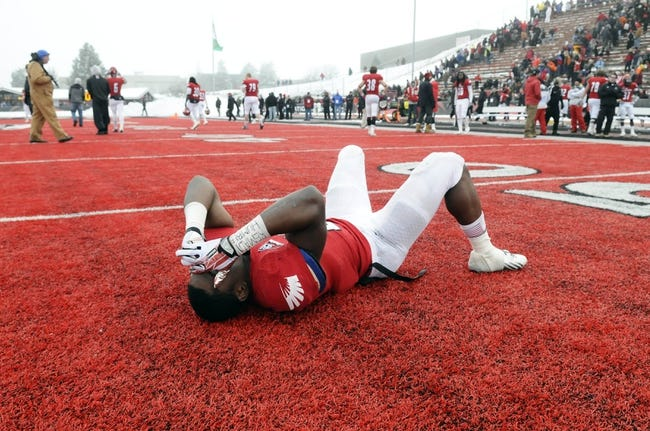 Dec 21, 2013; Cheney, WA, USA; Eastern Washington Eagles running back Quincy Forte (22) reacts after a game against the Towson Tigers at Roos Field. The Tiger beat Eagles 35-31. Mandatory Credit: James Snook-USA TODAY Sports