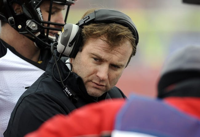 Dec 21, 2013; Cheney, WA, USA; Towson Tigers head coach Rob Ambrose huddles up with his team against the Eastern Washington Eagles during the first  half at Roos Field. Mandatory Credit: James Snook-USA TODAY Sports