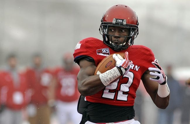 Dec 21, 2013; Cheney, WA, USA; Eastern Washington Eagles running back Quincy Forte (22) runs against the Towson Tigers during the first half at Roos Field. Mandatory Credit: James Snook-USA TODAY Sports