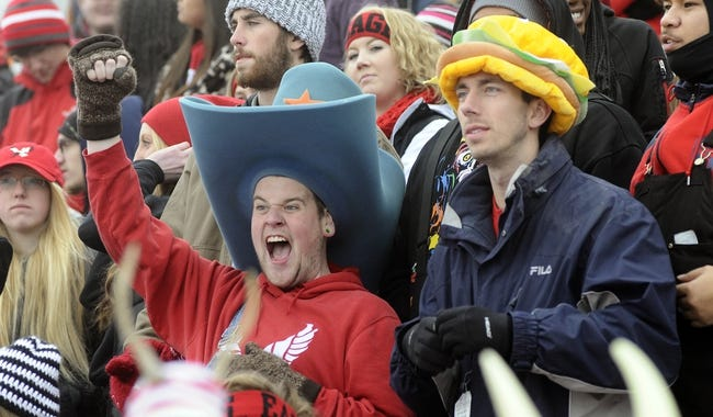 Dec 21, 2013; Cheney, WA, USA; Eastern Washington Eagles students react to a play against the Towson Tigers during the first  half at Roos Field. Mandatory Credit: James Snook-USA TODAY Sports