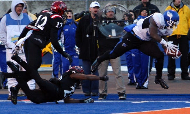 Dec 21, 2013; Boise, ID, USA; Buffalo Bulls running back Branden Oliver (32) dives in for a touchdown during the first half of the Idaho Potato Bowl against the San Diego State Aztecs at Bronco Stadium. Mandatory Credit: Brian Losness-USA TODAY Sports