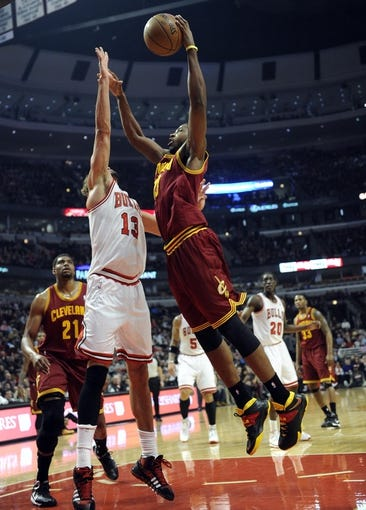 Dec 21, 2013; Chicago, IL, USA; Chicago Bulls center Joakim Noah (13) defends Cleveland Cavaliers power forward Tristan Thompson (13) during the first quarter at the United Center. Mandatory Credit: David Banks-USA TODAY Sports