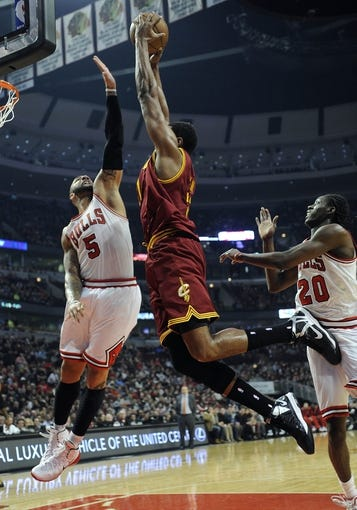 Dec 21, 2013; Chicago, IL, USA; Chicago Bulls power forward Carlos Boozer (5) defends Cleveland Cavaliers center Andrew Bynum (21) during the first quarter at the United Center. Mandatory Credit: David Banks-USA TODAY Sports