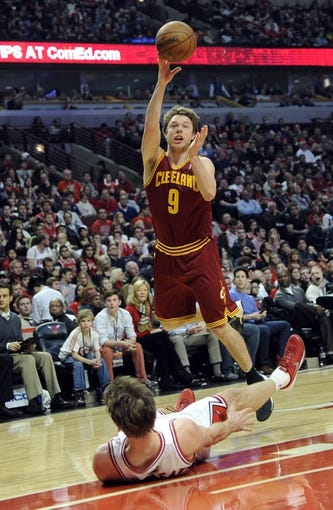Dec 21, 2013; Chicago, IL, USA;  Cleveland Cavaliers shooting guard Matthew Dellavedova (9) is fouled by Chicago Bulls small forward Mike Dunleavy (34) during the first quarter at the United Center. Mandatory Credit: David Banks-USA TODAY Sports