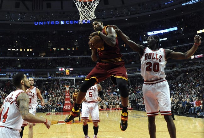 Dec 21, 2013; Chicago, IL, USA; Cleveland Cavaliers power forward Tristan Thompson (13) grabs a rebound in front of Chicago Bulls small forward Tony Snell (20) during the first quarter at the United Center. Mandatory Credit: David Banks-USA TODAY Sports