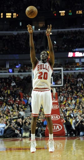 Dec 21, 2013; Chicago, IL, USA; Chicago Bulls small forward Tony Snell (20) shoots a three point shot against the Cleveland Cavaliers during the second half at the United Center. T'he Chicago Bulls defeated the Cleveland Cavaliers 100-84. Mandatory Credit: David Banks-USA TODAY Sports
