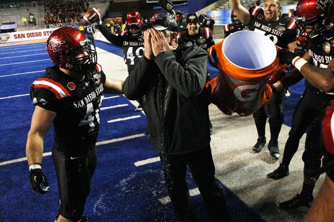 Dec 21, 2013; Boise, ID, USA; San Diego State Aztecs head coach Rocky Long is dunked with Gatorade after the Idaho Potato Bowl against the Buffalo Bulls at Bronco Stadium. San Diego defeated Buffalo 49-24. Mandatory Credit: Brian Losness-USA TODAY Sports