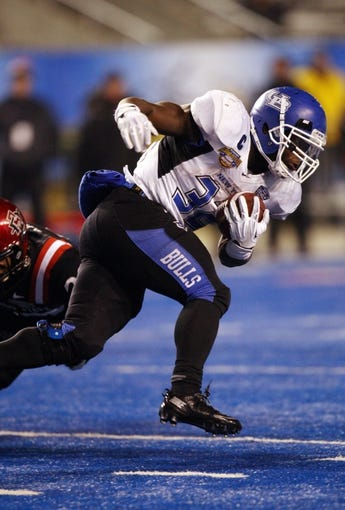 Dec 21, 2013; Boise, ID, USA; Buffalo Bulls running back Branden Oliver (32) during the second half of the Idaho Potato Bowl against the San Diego State Aztecs at Bronco Stadium. San Diego defeated Buffalo 49-24. Mandatory Credit: Brian Losness-USA TODAY Sports