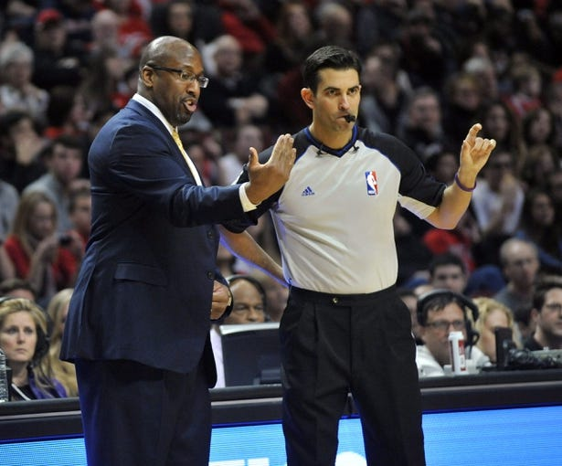 Dec 21, 2013; Chicago, IL, USA; Cleveland Cavaliers head coach Mike Brown questions a call with referee Zach Zarba during a game against the Chicago Bulls at the United Center. T'he Chicago Bulls defeated the Cleveland Cavaliers 100-84. Mandatory Credit: David Banks-USA TODAY Sports