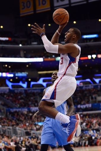 Dec 21, 2013; Los Angeles, CA, USA;  Los Angeles Clippers point guard Chris Paul (3) shoots in the second half of the game against the Denver Nuggets at Staples Center. The Clippers won 112-91. Mandatory Credit: Jayne Kamin-Oncea-USA TODAY Sports