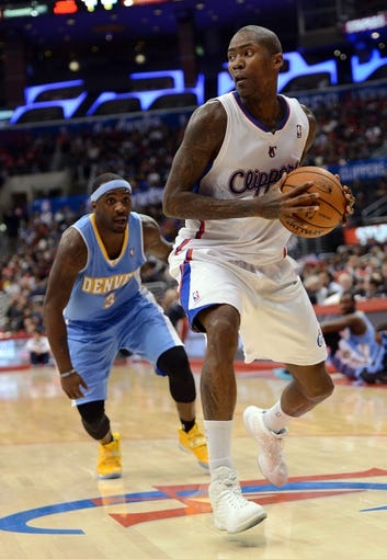 Dec 21, 2013; Los Angeles, CA, USA;  Denver Nuggets point guard Ty Lawson (3) guards Los Angeles Clippers shooting guard Jamal Crawford (11) in the second half of the game at Staples Center. The Clippers won 112-91. Mandatory Credit: Jayne Kamin-Oncea-USA TODAY Sports