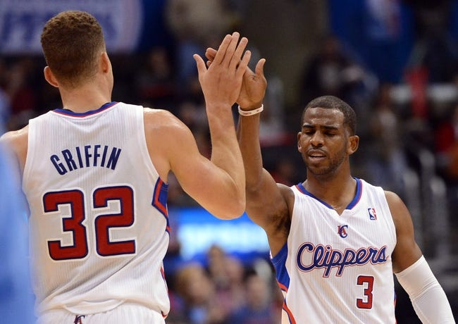 Dec 21, 2013; Los Angeles, CA, USA;  Los Angeles Clippers point guard Chris Paul (3) and power forward Blake Griffin (32) high five in the second half of the game against the Denver Nuggets at Staples Center. The Clippers won 112-91. Mandatory Credit: Jayne Kamin-Oncea-USA TODAY Sports