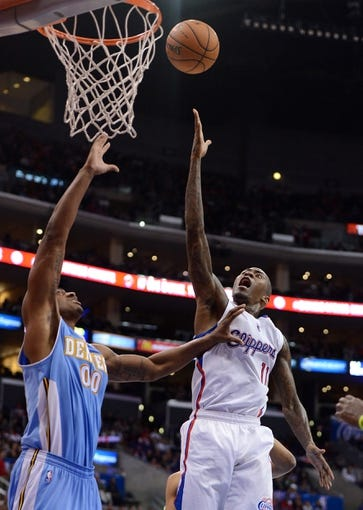Dec 21, 2013; Los Angeles, CA, USA;  Denver Nuggets power forward Darrell Arthur (00) defends Los Angeles Clippers shooting guard Jamal Crawford (11) in the second half of the game at Staples Center. The Clippers won 112-91. Mandatory Credit: Jayne Kamin-Oncea-USA TODAY Sports