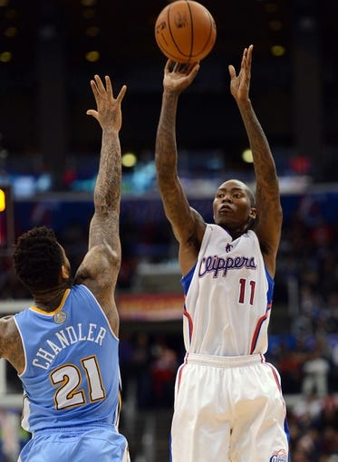 Dec 21, 2013; Los Angeles, CA, USA;  Denver Nuggets small forward Wilson Chandler (21) guards Los Angeles Clippers shooting guard Jamal Crawford (11) in the second half of the game at Staples Center. The Clippers won 112-91. Mandatory Credit: Jayne Kamin-Oncea-USA TODAY Sports