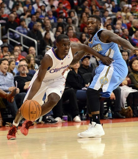 Dec 21, 2013; Los Angeles, CA, USA;  Denver Nuggets point guard Nate Robinson (10) guards Los Angeles Clippers point guard Darren Collison (2) in the second half of the game at Staples Center. The Clippers won 112-91. Mandatory Credit: Jayne Kamin-Oncea-USA TODAY Sports
