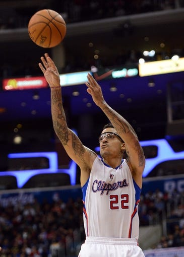 Dec 21, 2013; Los Angeles, CA, USA;  Los Angeles Clippers small forward Matt Barnes (22) shoots in the second half of the game against the Denver Nuggets at Staples Center. The Clippers won 112-91. Mandatory Credit: Jayne Kamin-Oncea-USA TODAY Sports