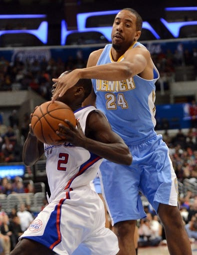 Dec 21, 2013; Los Angeles, CA, USA;  Denver Nuggets point guard Andre Miller (24) defends Los Angeles Clippers point guard Darren Collison (2) in the second half of the game at Staples Center. The Clippers won 112-91. Mandatory Credit: Jayne Kamin-Oncea-USA TODAY Sports