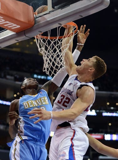 Dec 21, 2013; Los Angeles, CA, USA;  Los Angeles Clippers power forward Blake Griffin (32) shoots over Denver Nuggets small forward Quincy Miller (30) in the second half of the game at Staples Center. The Clippers won 112-91. Mandatory Credit: Jayne Kamin-Oncea-USA TODAY Sports