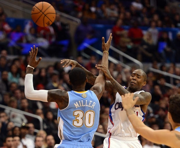 Dec 21, 2013; Los Angeles, CA, USA;  Los Angeles Clippers shooting guard Jamal Crawford (11) is fouled by Denver Nuggets small forward Quincy Miller (30) in the second half of the game at Staples Center. The Clippers won 112-91. Mandatory Credit: Jayne Kamin-Oncea-USA TODAY Sports