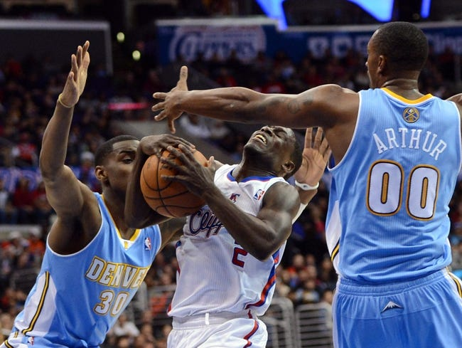 Dec 21, 2013; Los Angeles, CA, USA;  Denver Nuggets small forward Quincy Miller (30) guards Los Angeles Clippers point guard Darren Collison (2) as he is fouled by Denver Nuggets power forward Darrell Arthur (00) in the second half of the game at Staples Center. The Clippers won 112-91. Mandatory Credit: Jayne Kamin-Oncea-USA TODAY Sports