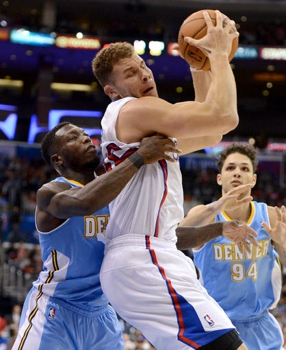Dec 21, 2013; Los Angeles, CA, USA;  Los Angeles Clippers power forward Blake Griffin (32) is fouled by Denver Nuggets point guard Nate Robinson (10) in the second half of the game at Staples Center. The Clippers won 112-91. Mandatory Credit: Jayne Kamin-Oncea-USA TODAY Sports