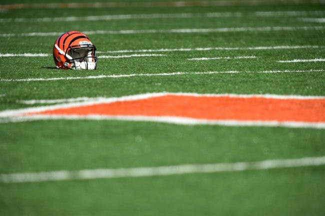 Dec 8, 2013; Cincinnati, OH, USA; A Cincinnati Bengals helmet sits on the field during warm up before the game against the Minnesota Vikings at Paul Brown Stadium. Mandatory Credit: Marc Lebryk-USA TODAY Sports