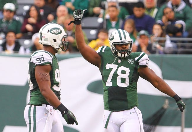 Dec 22, 2013; East Rutherford, NJ, USA; New York Jets defensive tackle Leger Douzable (78) celebrates his sack of Cleveland Browns quarterback Jason Campbell (not shown) during the second half at MetLife Stadium.  The Jets defeated the Browns 24-13.  Mandatory Credit: Ed Mulholland-USA TODAY Sports