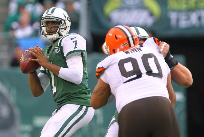 Dec 22, 2013; East Rutherford, NJ, USA; New York Jets quarterback Geno Smith (7) looks to pass while being rushed by Cleveland Browns defensive end Billy Winn (90) during the second half at MetLife Stadium.  The Jets defeated the Browns 24-13.  Mandatory Credit: Ed Mulholland-USA TODAY Sports