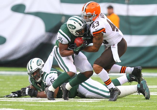 Dec 22, 2013; East Rutherford, NJ, USA; New York Jets running back Bilal Powell (29) is tackled by Cleveland Browns strong safety T.J. Ward (43) during the second half at MetLife Stadium.  The Jets defeated the Browns 24-13.  Mandatory Credit: Ed Mulholland-USA TODAY Sports