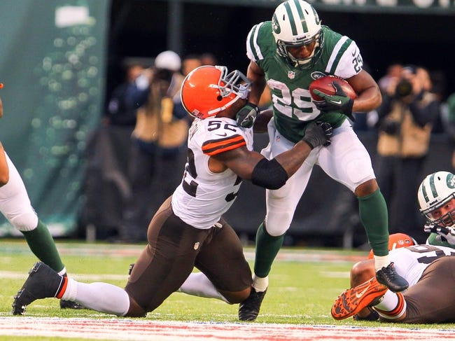 Dec 22, 2013; East Rutherford, NJ, USA; New York Jets running back Bilal Powell (29) runs with the ball while being pursued by Cleveland Browns inside linebacker D'Qwell Jackson (52) during the second half at MetLife Stadium.  The Jets defeated the Browns 24-13.  Mandatory Credit: Ed Mulholland-USA TODAY Sports
