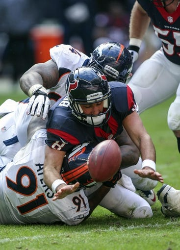 Dec 22, 2013; Houston, TX, USA; Houston Texans quarterback Matt Schaub (8) fumbles the ball after being sacked during the third quarter against the Denver Broncos at Reliant Stadium. The Broncos defeated the Texans 37-13. Mandatory Credit: Troy Taormina-USA TODAY Sports