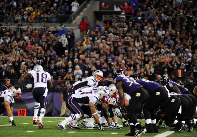 Dec 22, 2013; Baltimore, MD, USA; New England Patriots quarterback Tom Brady (12) prepares to take the snap during the game against the Baltimore Ravens at M&T Bank Stadium. Mandatory Credit: Evan Habeeb-USA TODAY Sports