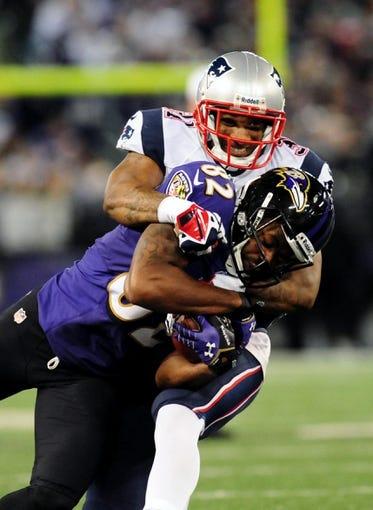 Dec 22, 2013; Baltimore, MD, USA; Baltimore Ravens wide receiver Torrey Smith (82) is tackled by New England Patriots cornerback Aqib Talib (31) at M&T Bank Stadium. Mandatory Credit: Evan Habeeb-USA TODAY Sports