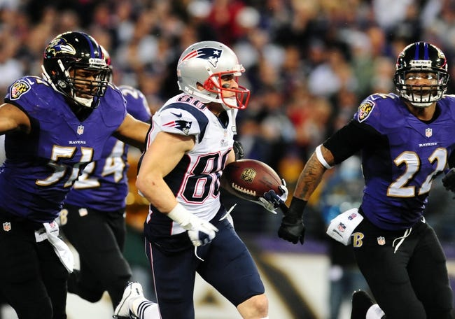 Dec 22, 2013; Baltimore, MD, USA; New England Patriots wide receiver Danny Amendola (80) runs with the ball while being chased by Baltimore Ravens linebacker Daryl Smith (51) and cornerback Jimmy Smith (22) at M&T Bank Stadium. Mandatory Credit: Evan Habeeb-USA TODAY Sports