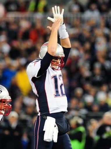 Dec 22, 2013; Baltimore, MD, USA; New England Patriots quarterback Tom Brady (12) calls a timeout against the Baltimore Ravens at M&T Bank Stadium. Mandatory Credit: Evan Habeeb-USA TODAY Sports