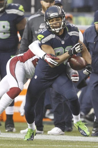 Dec 22, 2013; Seattle, WA, USA; Seattle Seahawks wide receiver Golden Tate (81) fumbles while running for yardage after the catch against the Arizona Cardinals during the fourth quarter at CenturyLink Field. Mandatory Credit: Joe Nicholson-USA TODAY Sports