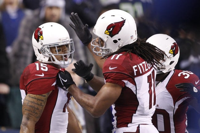 Dec 22, 2013; Seattle, WA, USA; Arizona Cardinals wide receiver Michael Floyd (15) is congratulated by Arizona Cardinals wide receiver Larry Fitzgerald (11) after catching a touchdown against the Seattle Seahawks during the fourth quarter at CenturyLink Field. Mandatory Credit: Joe Nicholson-USA TODAY Sports