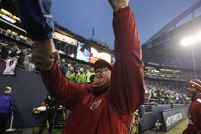 Dec 22, 2013; Seattle, WA, USA; Arizona Cardinals head coach Bruce Arians shakes hands with fans following a 17-10 Arizona victory against the Seattle Seahawks at CenturyLink Field. Mandatory Credit: Joe Nicholson-USA TODAY Sports