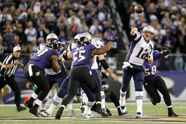 Dec 22, 2013; Baltimore, MD, USA; New England Patriots quarterback Tom Brady (12) passes e against the Baltimore Ravens at M&T Bank Stadium. Mandatory Credit: Mitch Stringer-USA TODAY Sports